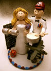 Jet Pilot with his drum and baseball hat, and bride with her weights and blackboard